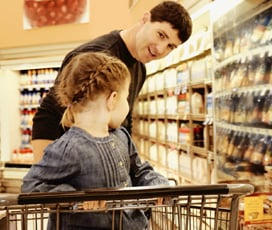 Father looking at daughter in grocery store